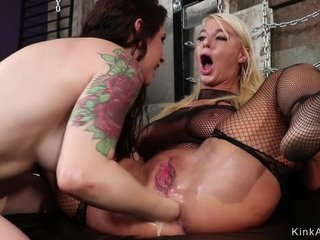 Gorgeous blonde MILF fucks her younger GF with strapon